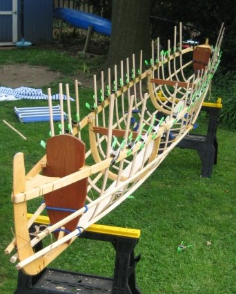 Skin-on-frame outrigger canoe with ribs