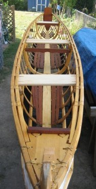Skin-on-frame outrigger canoe, with floorboards and thwarts in