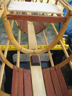 Skin-on-frame outrigger canoe, with floorboards and mast step in