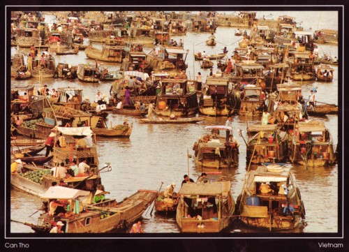 postcard from Vietnam showing harbor full of traditional boats